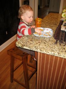 Eating at the counter like a big guy. Gosh, he is getting so big!