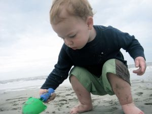 Nash LOVED the beach and sand