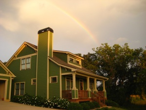 A rainbow marks the sky above our home