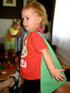 His awesome superhero cape (made by Kris!)